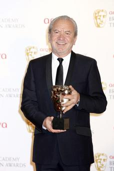 LONDON, ENGLAND - MAY 27: Winner of Best Reality and Constructed Factual for 'The Young Apprentice' Lord Alan Sugar poses in front of the winners boards at The 2012 Arqiva British Academy Television Awards at the Royal Festival Hall on May 27, 2012 in London, England. (Photo by Tim Whitby/Getty Images)