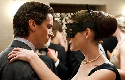 Christian Bale as Bruce Wayne, left, and Anne Hathaway as Selina Kyle in a scene from the action thriller 'The Dark Knight Rises.'