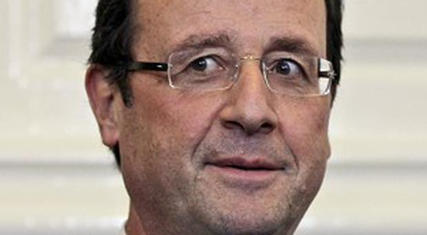 Francois Hollande says one of the highest ranking officials to defect from Bashar Assad's Syrian regime is in Paris
