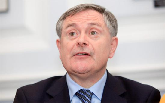 Minister for Public Expenditure and Reform Brendan Howlin TD during a media briefing at the Department of Finance, Dublin.