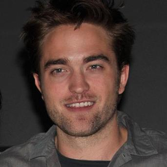 Robert Pattinson was not overjoyed to wear a wig for the last Twilight film