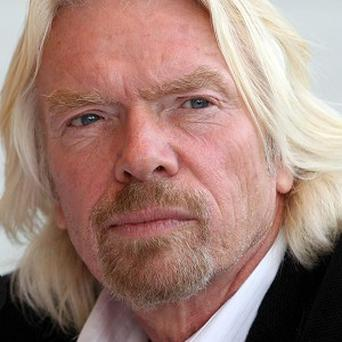 Sir Richard Branson is looking into buying back Virgin Records