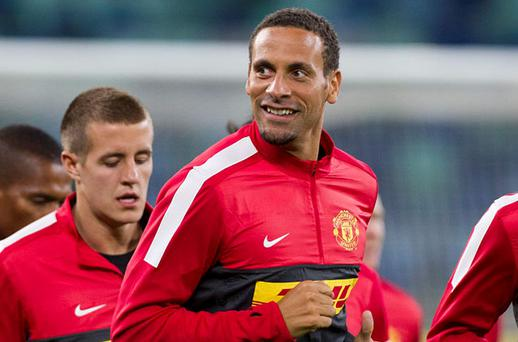 Manchester United's Rio Ferdinand smiles at the fans during training ahead of a warm up match against AmaZulu, in Durban