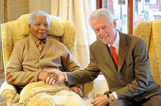 Former US President, Bill Clinton, right, meets with former South African President Nelson Mandela at his home in Qunu, South Africa. Photo: AP