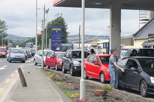 A half-price sale on unleaded petrol at a Letterkenny pump station had cars lining up from almost half a mile away yesterday