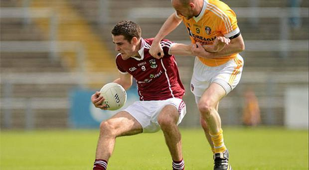 Fiontain O'Curraoin, Galway, in action against Aodhan Gallagher, Antrim. Photo: Sportsfile