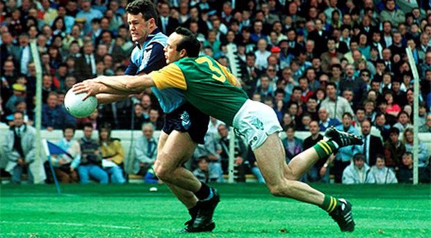 Action from '91 as Dublin's Vinny Murphy is tackled by Meath full-back Mick Lyons