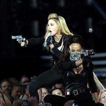 Madonna waved a gun as she performed in London's Hyde Park this week