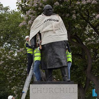 The statue of Sir Winston Churchill in Parliament Square is fitted with a straitjacket