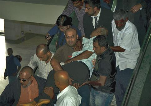 The chaotic scenes at a Mauritian court yesterday as the island's 'Sunday Times' editor, Imran Hosany, is carried out after collapsing