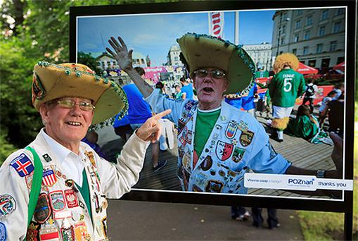Ireland fan Joe McDermott from Courtown views an image of himself at the official opening of 'Kings of the Craic' an exhibition of the Boys in Green invasion of Poznan during UEFA 2012 at the Summer House in St. Stephens Green