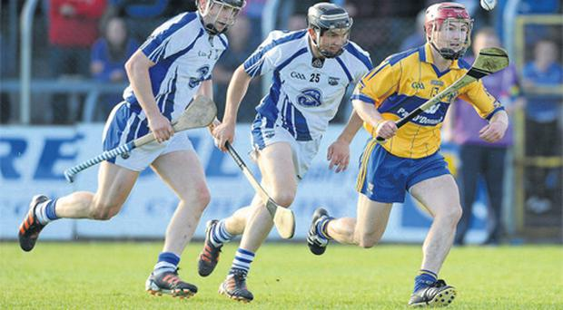 Clare's David O'Halloran is pursued by Waterford duo Philip Mahony, left, and Darragh Fives during their Bord Gáis Energy Munster U21 semi-final last night.