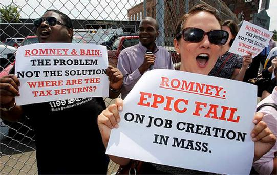 Protestors hold signs and chant slogans outside of Middlesex Truck and Coach where U.S. Republican presidential candidate and former Massachusetts Governor Mitt Romney was holding a campaign event in Roxbury, Massachusetts July 19, 2012. Photo: Reuters
