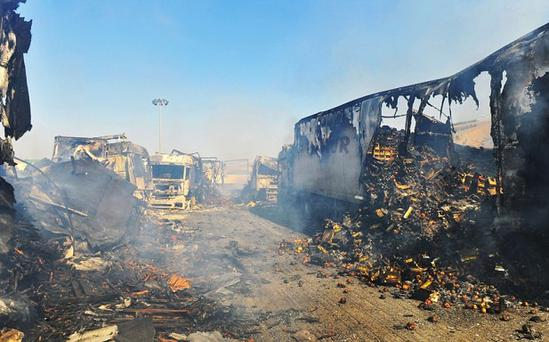 Burnt-out lorries following a fierce battle between Syrian rebel fighters and Syrian troops in Bab al-Hawa. Photo: Getty Images