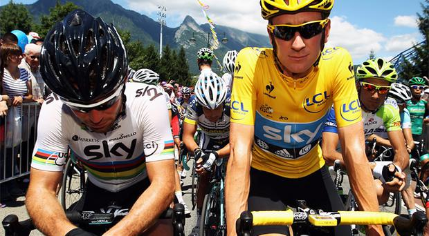 Race leader Bradley Wiggins of SKY Procycling lines up beside team mate and World Road Race Champion Mark Cavendish