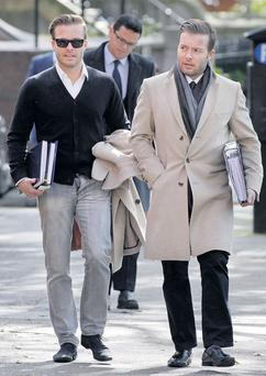 CRUMBLING EMPIRE: Simon and Christian Stokes outside the Employment Appeals Tribunal