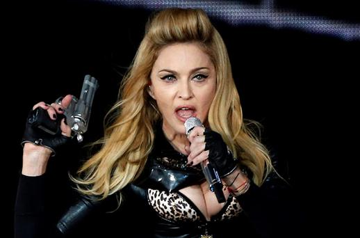 Madonna has caused controversy with her use of guns and swastikas on her MDNA tour