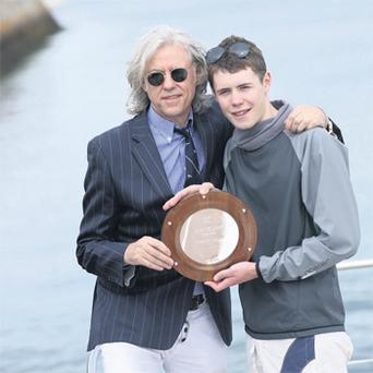 Bob Geldof presents Conor Ryan with the DMYC Bob Geldof Spirit Memorial Award in honour of his father, Bob Geldof snr, a founding member of Dun Laoghaire Motor Yacht Club