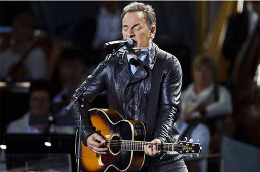 Bruce Springsteen performs during a concert at the City Hall Square in Oslo. The concert marks the first-year anniversary of the twin Oslo-Utoya massacre by Breivik in Norway. Photo: Reuters
