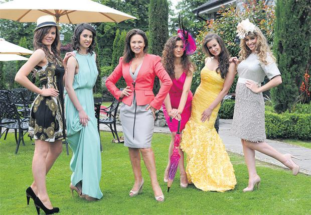 Celia Holman-Lee (centre) with (from left) models Colette Moloney, Laura O Shea, Catherine McCormac, Orla Eichholz and Becky Costello, wearing locally designed dresses to be showcased at the autumn/winter fashion show at The Rose of Tralee Festival. DOMINIC WALSH