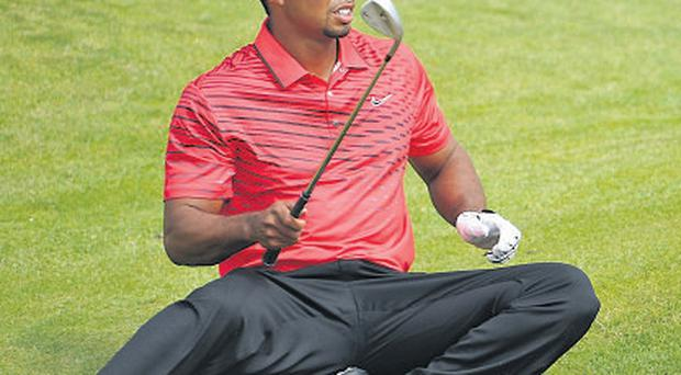 Tiger Woods has to improvise to play a bunker shot at The Open