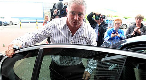 Rangers manager Ally McCoist leaves Ibrox Stadium in Glasgow following talks on the future of the club