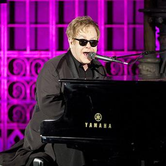 Sir Elton John has topped the UK album chart with Good Morning To The Night