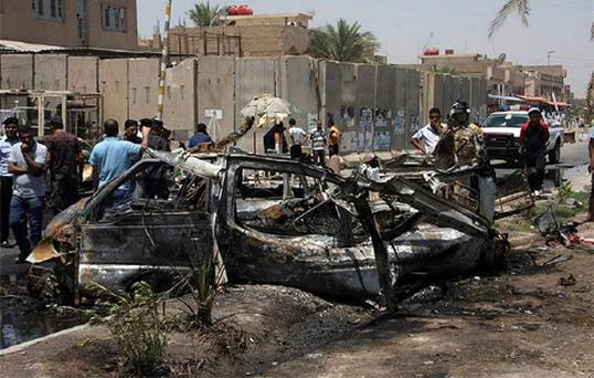 Two car bombs struck near a government building in Sadr City, a poor Shi'ite neighbourhood in Baghdad, and in the northern mainly Shi'ite area of Hussainiya, killing some 16 people and wounding about 73, police said. Photo: Reuters