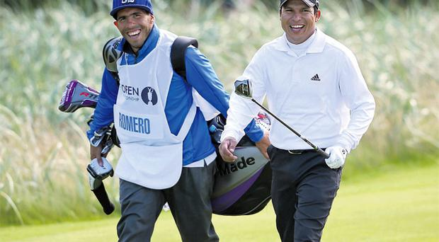 Andres Romero of Argentina and his guest caddie, Manchester City star Carlos Tevez, during the final round of the 141st Open Championship at Lytham & St Annes on Sunday