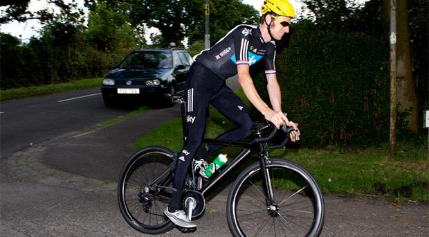 Tour De France Bradley Wiggins cycles on the road near his home in Eccleston yesterday
