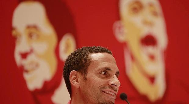 Manchester United's Rio Ferdinand talks to the press ahead og their friendly match against Shanghai Shenhua