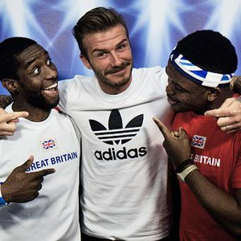 Raymond Mfon and Paul Fagbuaro with David Beckham, who dropped in on their photo booth snapshots (Adidas)