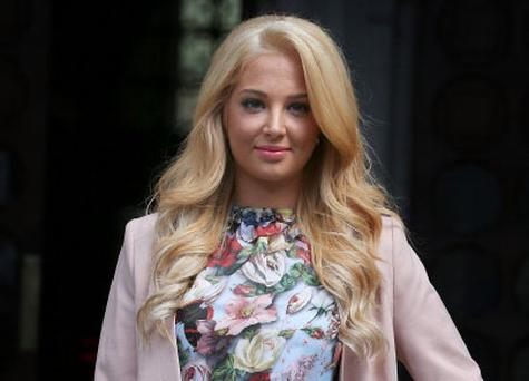 LONDON, ENGLAND - JULY 12: Tulisa Contostavlos leaves the Royal Courts of Justice on July 12, 2012 in London, England. The pop star and X Factor judge today settled her legal action over the publication of a private video tape by her former boyfriend Justin Edwards. (Photo by Peter Macdiarmid/Getty Images)