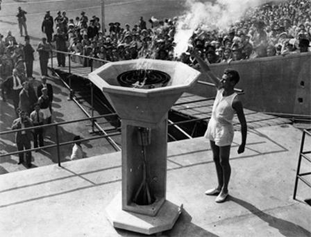 British athlete John Mark lights the Olympic Flame at the opening ceremony of the 1948 Olympic Games at Wembley Stadium, London