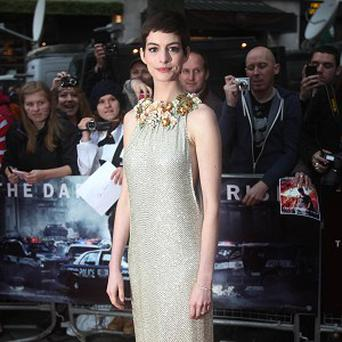 Anne Hathaway has expressed her condolences following the shootings at a Batman screening in Colorado