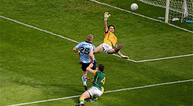 Eoghan O'Gara, Dublin, kicks the ball past Meath goalkeeper David Gallagher, the umpire initially signalled that the shot had gone wide, but referee Marty Duffy over-ruled him after seeing the replay on the big screen