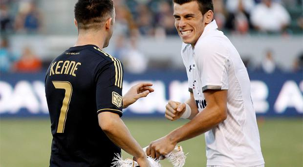 Tottenham Hotspur's Gareth Bale smiles with Los Angeles Galaxy's Robbie Keane before their friendly soccer match