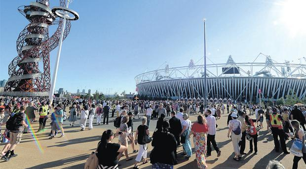 Crowds arrive for an opening ceremony rehearsal at the Olympic Park in London this week