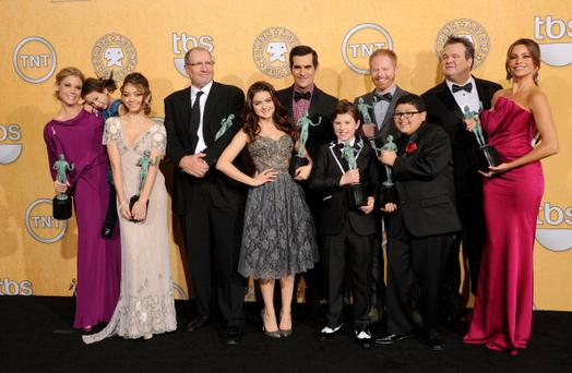 LOS ANGELES, CA - JANUARY 29: The cast of 'Modern Family' pose in the press room with their Outstanding Performance By An Ensemble In A Comedy Series award for 'Modern Family' during the 18th Annual Screen Actors Guild Awards at The Shrine Auditorium on January 29, 2012 in Los Angeles, California. (Photo by Jason Merritt/Getty Images)