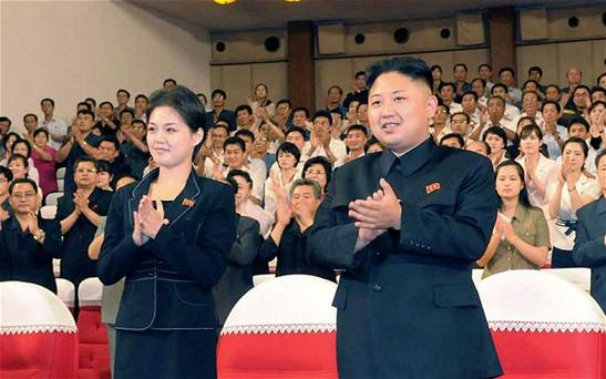 There are also suggestions that the 28-year-old leader of North Korea is trying to break with established protocol by showing off his new wife. Photo: AP