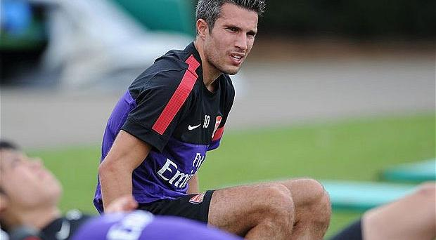 Tug-of-war: Robin van Persie is likely to leave Arsenal this summer Photo: Getty Images