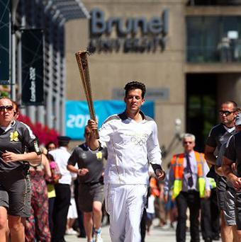 Mark Ronson carried the Olympic Flame through Brunel University in London