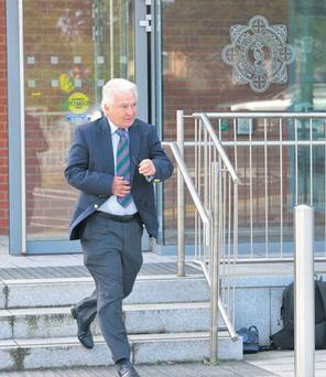 Sean FitzPatrick signs on at Irishtown garda station yesterday as part of his bail agreement