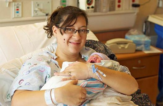 Katie Medley sits with her new-born son, Hugo Jackson Medley, at University of Colorado Hospital in Aurora July 24, 2012.