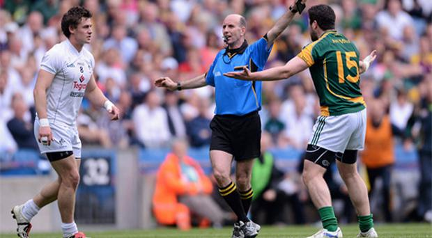Referee Michael Collins signals the end of the first half as Meath's Cian Ward remonstrates with him as he blew his whistle when a Meath player had tried to kick a point from play.