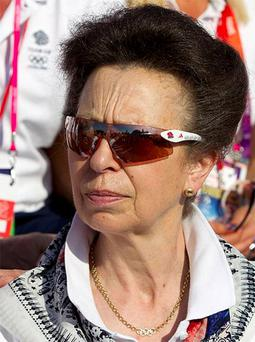 Princess Anne watches the welcoming ceremony for Team GB in the Olympic Village in London July 24, 2012. Photo: Reuters