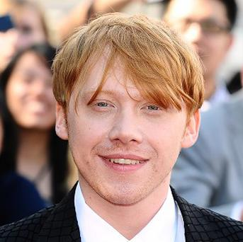 Rupert Grint says he likes watching rather than playing sport