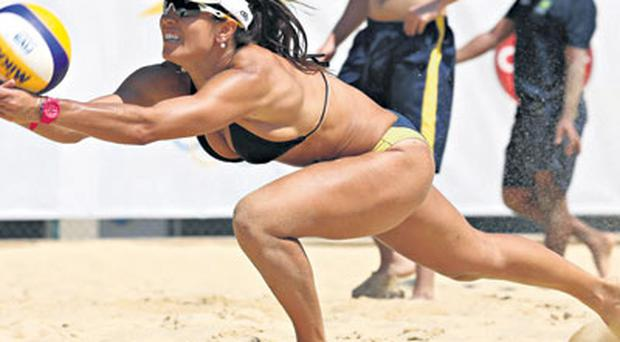 Brazil's Maria Elisa takes part in a practice session for the women's beach volleyball competition at the London Olympic Games.
