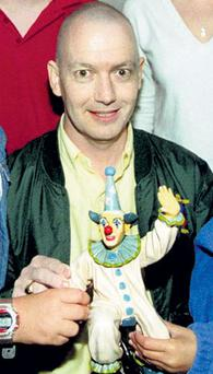 Ger Doyle in 1999, after his release from hospital following treatment for leukaemia, holding a clown that was presented to him by local children