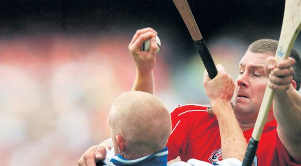 Cork's Diarmuid O'Sullivan battles with John Mullane of Waterford during the All-Ireland SHC quarter-final at Croke Park in 2007. The latest episode in the rivalry will take place at Semple Stadium tomorrow